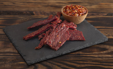 Pile Hot and Spicy Beef Jerky with Red Pepper Flakes