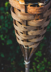 Abstract close up bamboo tiki torch