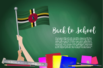 Vector flag of dominica on Black chalkboard background. Education Background with Hands Holding Up of dominica flag. Back to school with pencils, books