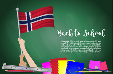 Vector flag of Norway on Black chalkboard background. Education Background with Hands Holding Up of Norway flag. Back to school with pencils, books, school items learning and childhood concept.
