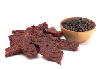 Pile of Black Pepper Beef Jerky on a White Background