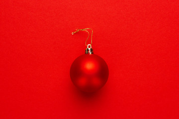 Christmas tree decoration ball on red background