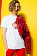 Handsome blonde guy doing fashion shoot