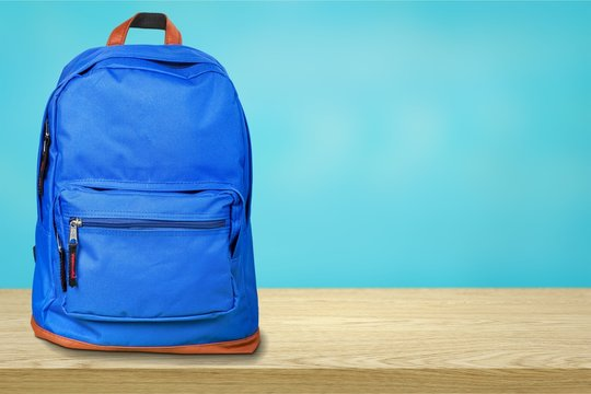 Blue school bag on background