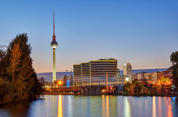 Dusk at the river Spree in Berlin with the famous Television Tower in the back