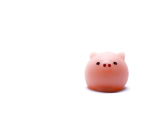A miniature toy, small pink pig isolated on white background with empty space