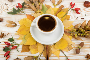 Mug of Coffee Surrounded By Leaves, Autumn Tree Seeds and Fragrant Spices
