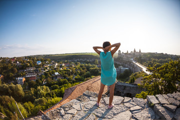 Girl on the background of a medieval fortress.