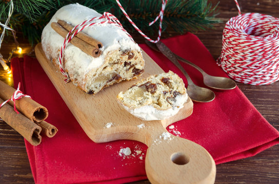 Traditional German cake Stollen, fruit bread with dried fruit and nuts, covered with powdered icing sugar, usually eaten during Christmas season and also called Weihnachtsstollen or Christstollen.