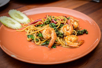 Stir-fried Spicy Spaghetti Seafood Thai food Style (Spaghetti Pad Kee Mao) in Orange Dish