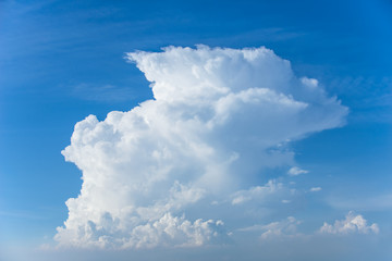 Rain clouds forming with blue sky background