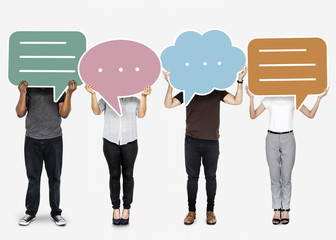 Diverse people holding speech bubble symbols