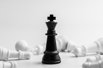 black king chess stand alone in among the losers. - Leader and business winner concept.