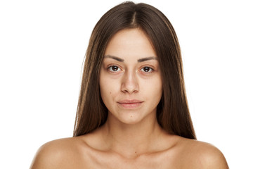 Portrait of young beautiful woman with no makeup on white backgeound