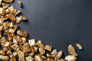 Gold nuggets on black background Wall mural
