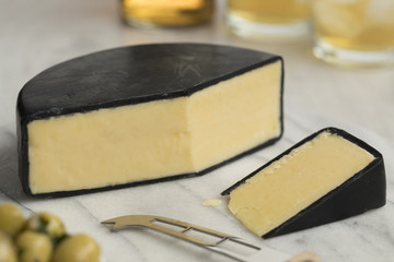 Piece of English waxed farmhouse cheddar cheese