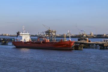 Ship moored near an oil refinery - Humber Estuary - England.