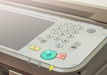 photocopier is a machine that makes paper copies of documents and other visual images ,close-up shot on working multi-function device, photocopier with luminous