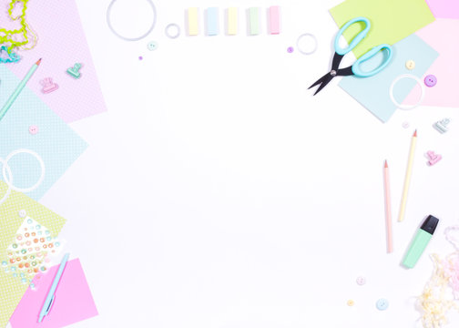 DIY Сraft supplies on a white background - scrapbook paper scissors button marker pencil cutting dies, workplace top view, flat.