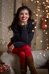 Happy beautiful young woman christmas lights