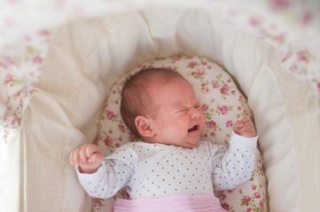 Crying newborn girl