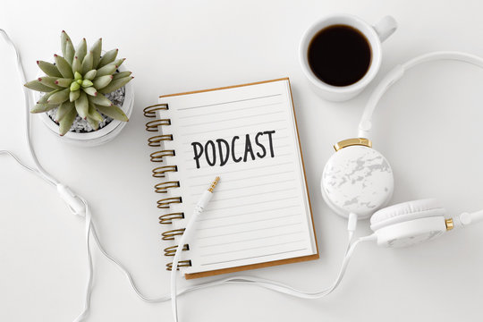 Podcast concept with headphones and notebook