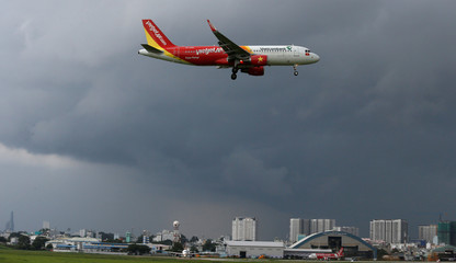 A Vietjet aircraft prepares for landing at Tan Son Nhat airport in Ho Chi Minh city