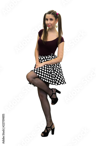 a585c32b5568ff Young pin up girl in polka-dot dress, black stockings and in high heels  shoes isolated on the white background.