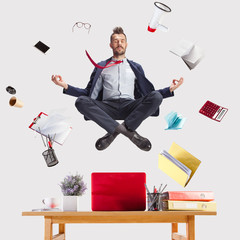 Recess Fitting Zen The young zen businessman relaxing at office in yoga pose lotus, while his work is doing. levitation concept