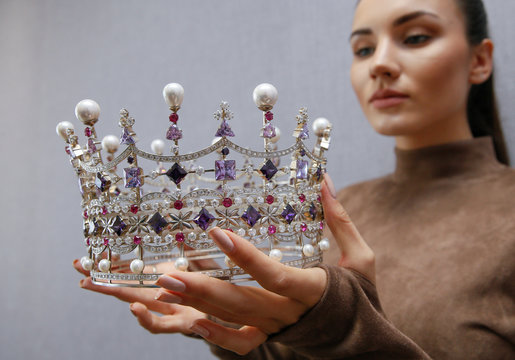 Victoriya Kiose Executive Director of Miss Ukraine contest shows crown during Reuters interview in Kiev