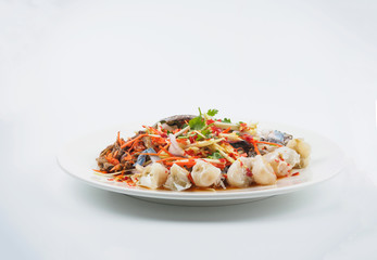 Thai style spicy salad with raw flower crab