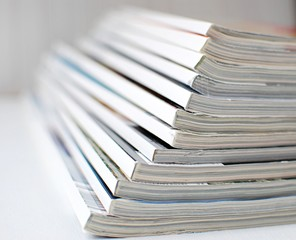 Stack of magazines, close up view.