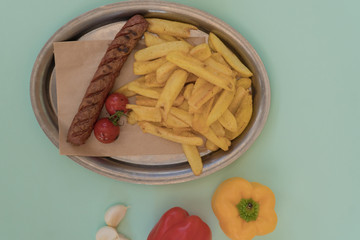 Grilled sausage with sauce and french fries