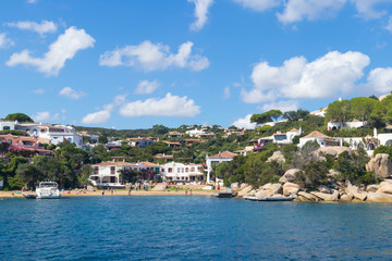 View on the beautiful village of Port Rafael from the sea, Sardinia, Italy.