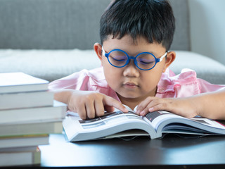 Boy reading a book at home. education concept