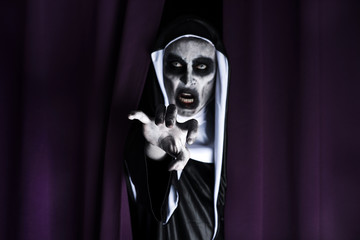 frightening evil nun, in a black and white habit