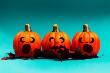 Halloween pumpkin jack o lantern decor with funny faces.