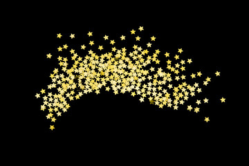 Group of gold star glitter isolated on black background  on top view