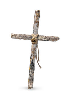 The cross is made of old wood and has a rope tied at the core. isolated on white background.