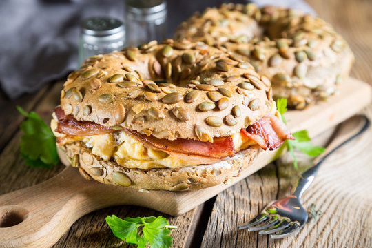 Breakfast bagel with omelet and bacon