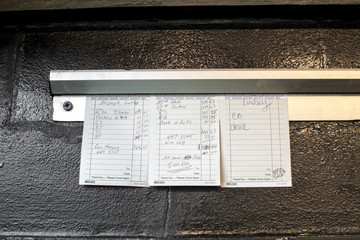 Checks and orders hanging from clip