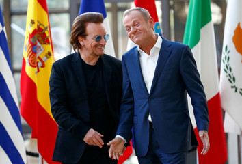 Bono, U2 singer and co-founder of the One campaign, talks with European Council President Donald Tusk in Brussels
