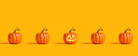 Halloween orange pumpkins on an orange background