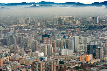 A layer of smog covers downtown Santiago, Chile