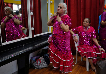 Senior citizens get ready backstage before performing in a play on the occasion of World Elders Day in Mumbai