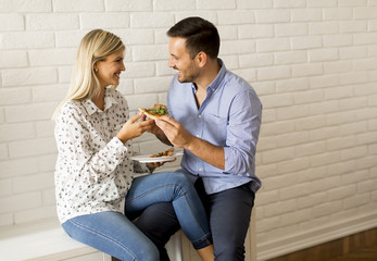 Lovely young couple eating pizza