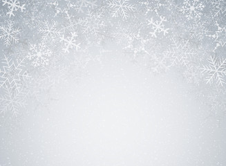Snowflakes in Christmas festival theme on blur gray gradient background with snow decoration.