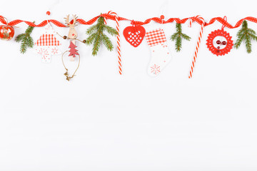 christmas or new year frame composition. christmas gold decorations on white background with empty copy space for text. holiday and celebration concept for postcard or invitation. top view. flat lay