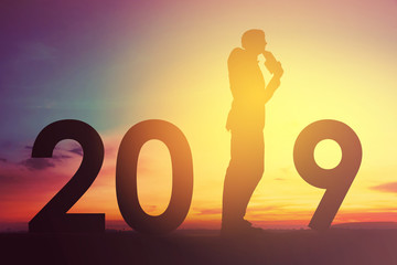 2019 happy new years christmas eve, Silhouette of a man is standing on thinking idea of new projects in outdoor