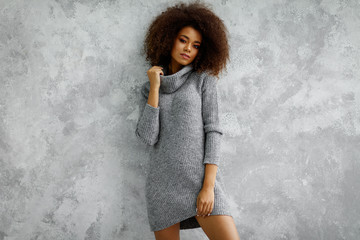 Wall Mural - Young black woman wear high-neck wool and cashmere oversized sweater